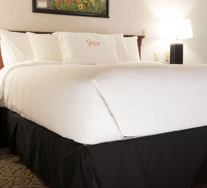 King sized bed with monogramed pillow